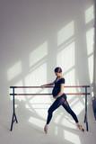 Young beautiful pregnant ballerina is posing in studio - 213071974