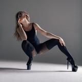 Young beautiful dancer is posing in studio - 213072345