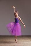 Young beautiful ballerina is posing in studio - 213072557