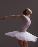 Young beautiful ballerina is posing in studio - 213072564