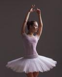 Young beautiful ballerina is posing in studio - 213072595