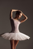 Young beautiful ballerina is posing in studio - 213072970