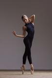 Young beautiful ballerina is posing in studio - 213073750