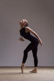 Young beautiful ballerina is posing in studio - 213073794