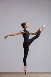 Young beautiful ballerina is posing in studio - 213073915
