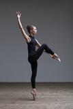 Young beautiful ballerina is posing in studio - 213073976
