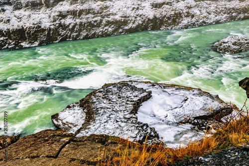 Close up of colourful water at Gullfoss waterfall, Iceland - 213077199
