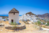 Iconic traditional wind mills in Ios island, Cyclades, Greece. - 213084521