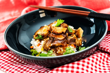 Vietnamese style caramel pork with rice and vegetable