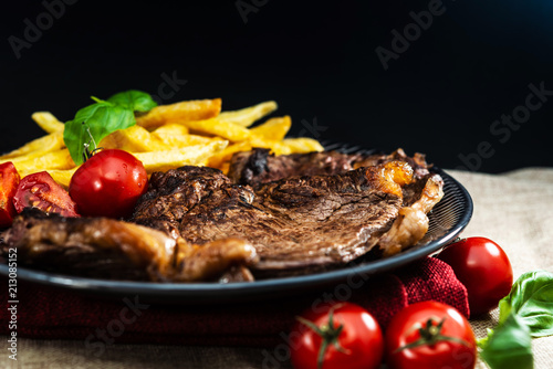 juicy steak beef meat with tomato and french fries - 213085152