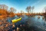 Early spring landscape with wooden boat - 213096182