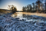Frozen morning landscape with a river - 213096322