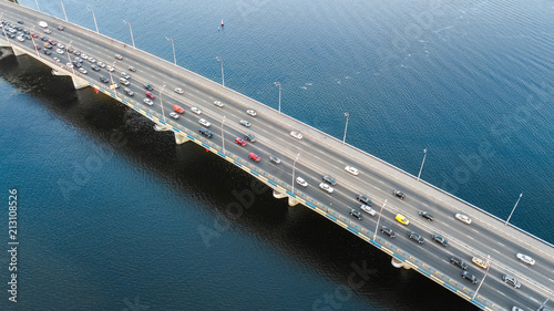 Poster Aerial top view of bridge road automobile traffic of many cars from above, city transportation concept