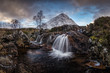 Amazing natural landscape of Scotland. A waterfall with snow covered mountain in the background. Scotland is just so beautiful. - 213112302