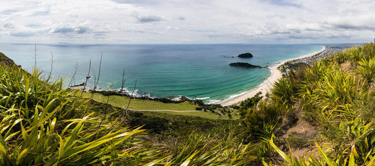 Panorama photo of a bay with clear water. Amazing New Zealand landscape. Island, beach, sand, sky, water, ocean, nature. © janstria