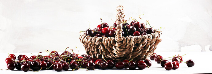 Cherry.A bunch of red fresh cherries on the table. © beats_