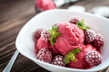Delicious ice cream  made from fresh berries on a wooden background