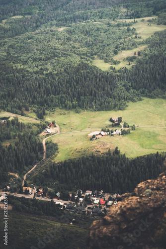 Plexiglas Khaki Top down view of a mountain town in Colorado during summer.