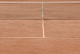 brown tennis court with tennis net