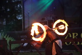 a man shows acrobatic tricks with fire - 213139183