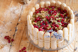 Sharlotta cake with blueberries, decorated with raspberries, red currant, white currant and lavender - 213156329