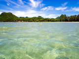 Wide view water movement of sea and the mountain with blue sky - 213177549