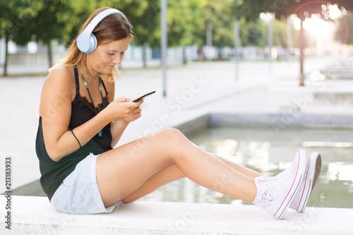 Fototapeta beautiful woman listening music with headphone