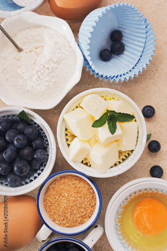 Wall mural Traditional set of ingredients for baking on marble table.