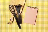 Blank sheet of opened notepad and kitchen utensils on  table with tablecloth, copy space - 213205113