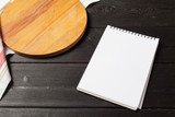 Blank sheet of opened notepad and kitchen utensils on  table with tablecloth, copy space - 213205178