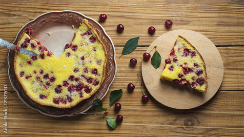 Foto Murales Homemade cherry pie on a wooden table