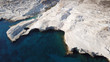 Aerial drone bird's eye view of iconic lunar volcanic white chalk iconic beach and caves of Sarakiniko, Milos island, Cyclades, Greece