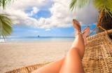 Sexy legs of a woman lying in a hammock - 213235390