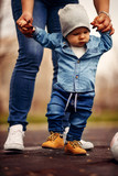 Mother is helping her boy taking his first steps - 213236187