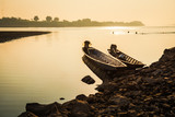 Fishing boat and sunrise in river