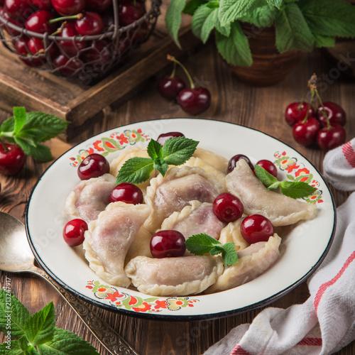 Fotobehang Kersen dumplings with cherry (Vareniki, pierogi), rustic background