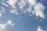 Plane in the clouds from below - 213256172