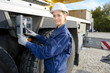Woman operating controls of plant machinery