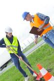 workers build concrete walkway in green field - 213264145