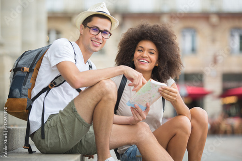 happy tourists with map sightseeing city