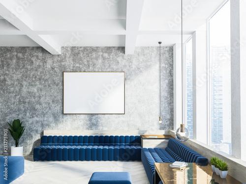 Concrete living room interior, blue sofa, poster