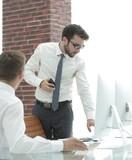 confident businessman solves work problems - 213290124