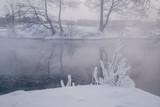Winter landscape with river and frozen trees - 213291388
