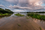 Stormy clouds over river - 213291790