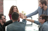 business team showing unity with their hands together - 213292541