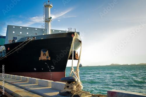 Fototapeta Big vessel moor with big rope at port terminal