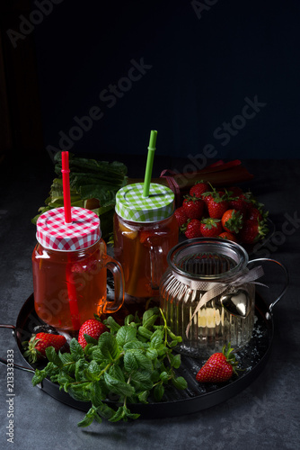 Foto Murales a fruit lemonade with strawberries rhubarb and mint