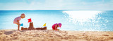Boy and girl playing on the beach - 213340754