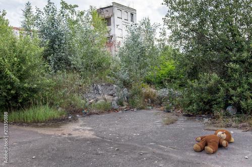 Fotobehang Oude verlaten gebouwen Lost plush bear in an abandoned factory