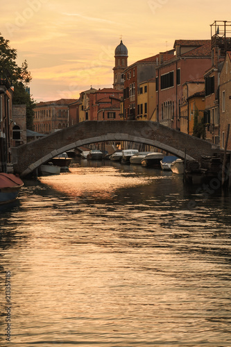 Idyllic sunset over the canal of Venice in Italy - 213357185